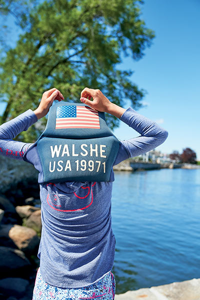 samara walshe puts on her life vest and gets ready for a day of sailing