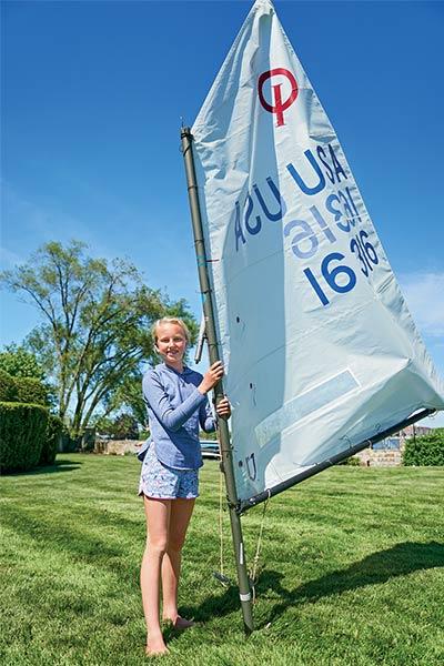 samara walshe poses with her sail