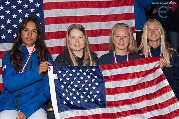 samara walshe poses with friends with the american flag