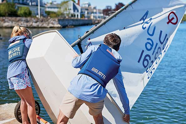 samara walshe gets her sailboat in the water with the help of some friends