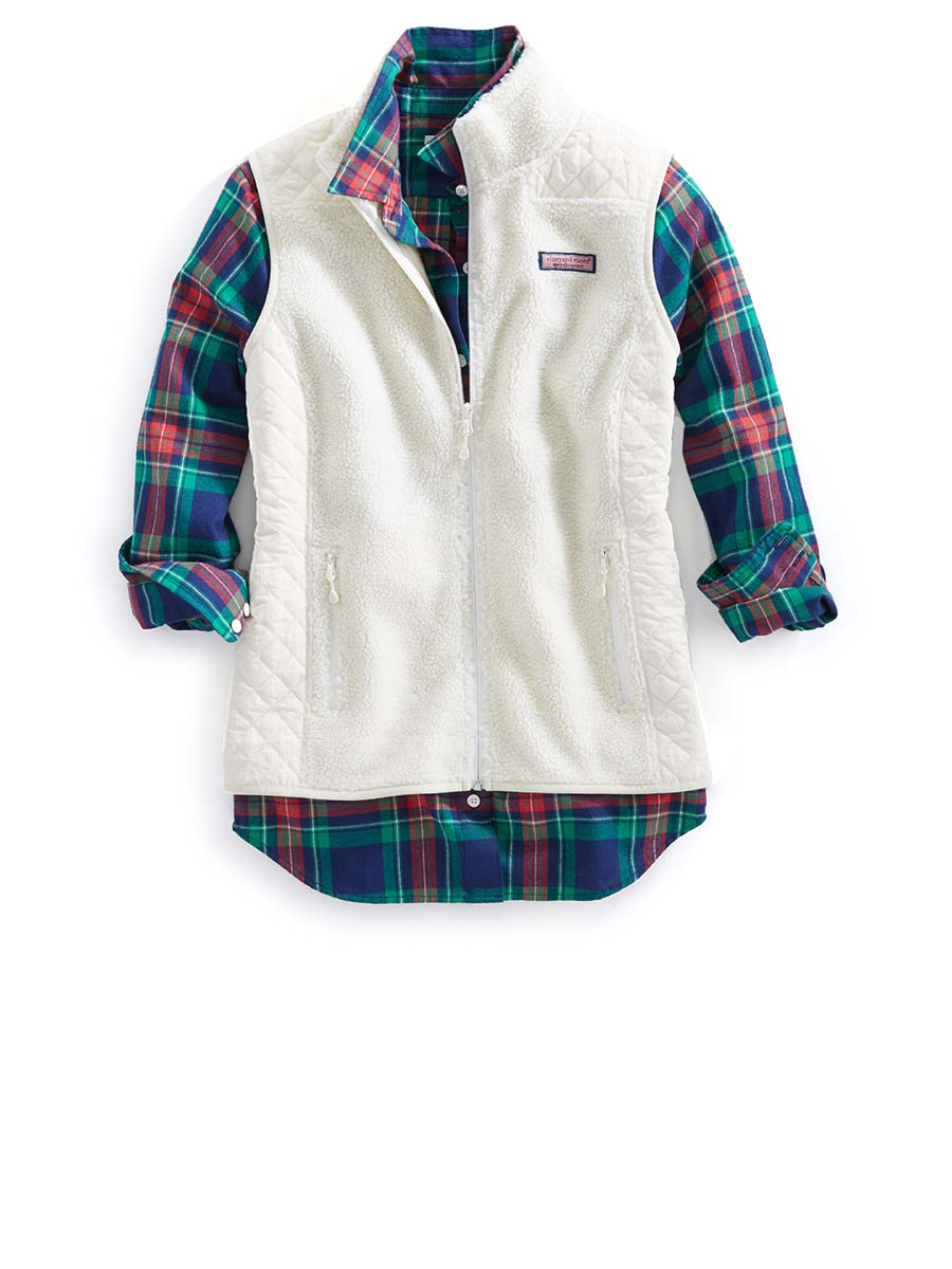 Photo of our new womens button up underneath our new womens vest.