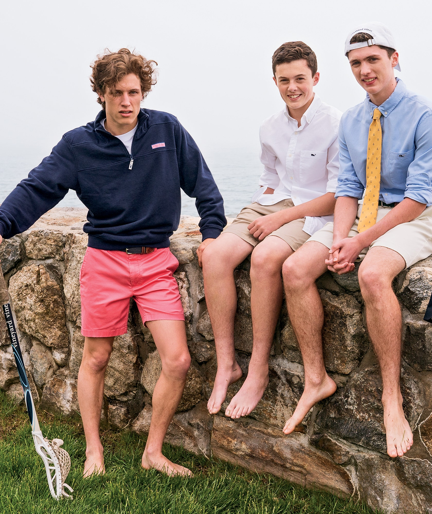 Boys sitting on wall with vineyard vines clothing