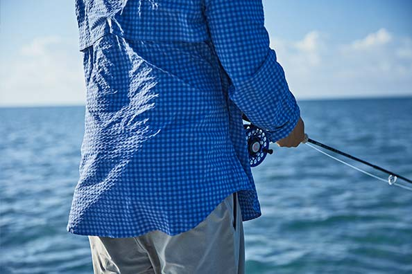 man fishing in vineyard vines harbor shirt