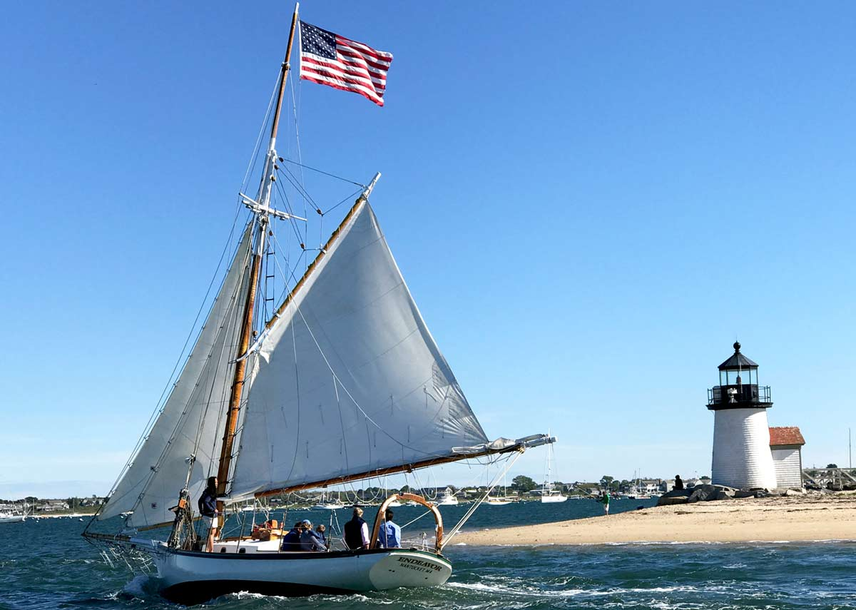 Sailboat and lighthouse - Nantucket, MA