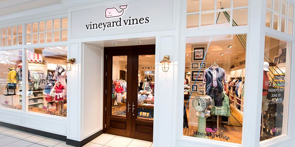 About Vineyard Vines. When one first hears the name Vineyard Vines, the first thing that often comes to mind is a place where you can shop for fine wines. Actually, this is an awesome clothing retailer that is popular throughout the United States. This store is so popular that the company has opened outlet stores.
